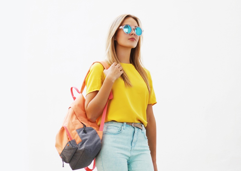 Blonde Model Yellow Shirt Backpack Jeans Sunglasses
