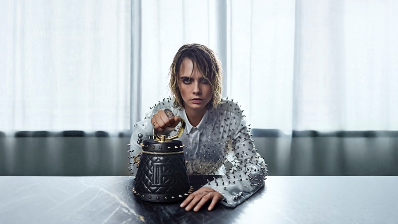 Cara Delevingne poses with Balmain Romeo bag