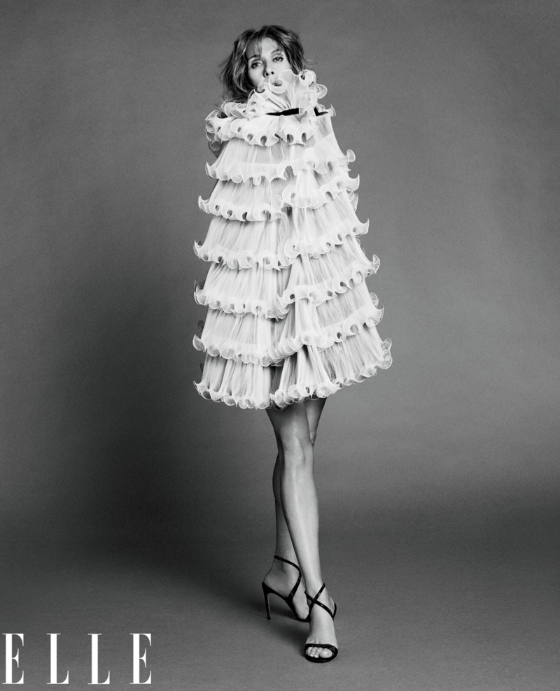 Celine Dion poses in Dior Haute Couture dress with René Caovilla sandals