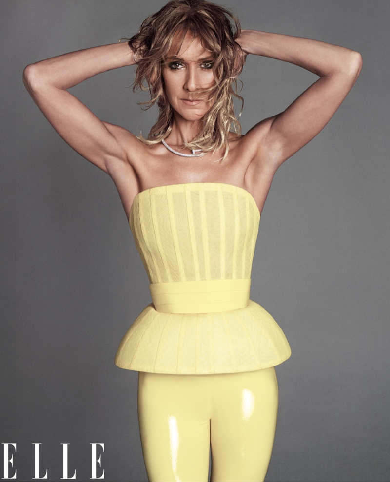 Dressed in yellow, Celine Dion wears Givenchy Haute Couture bustier and leggings with Cartier necklace