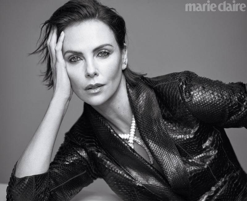 Charlize Theron poses in Brunello Cucinelli blazer and Bulgari necklace