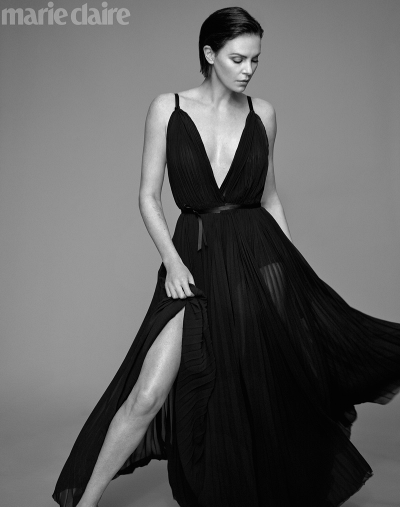 Striking a pose, Charlize Theron wears TRE by Natalie Ratabesi dress