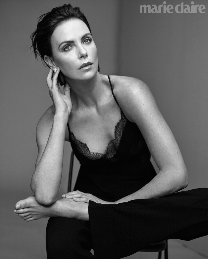Actress Charlize Theron wears Victoria Beckham top and pants with Bulgari earrings