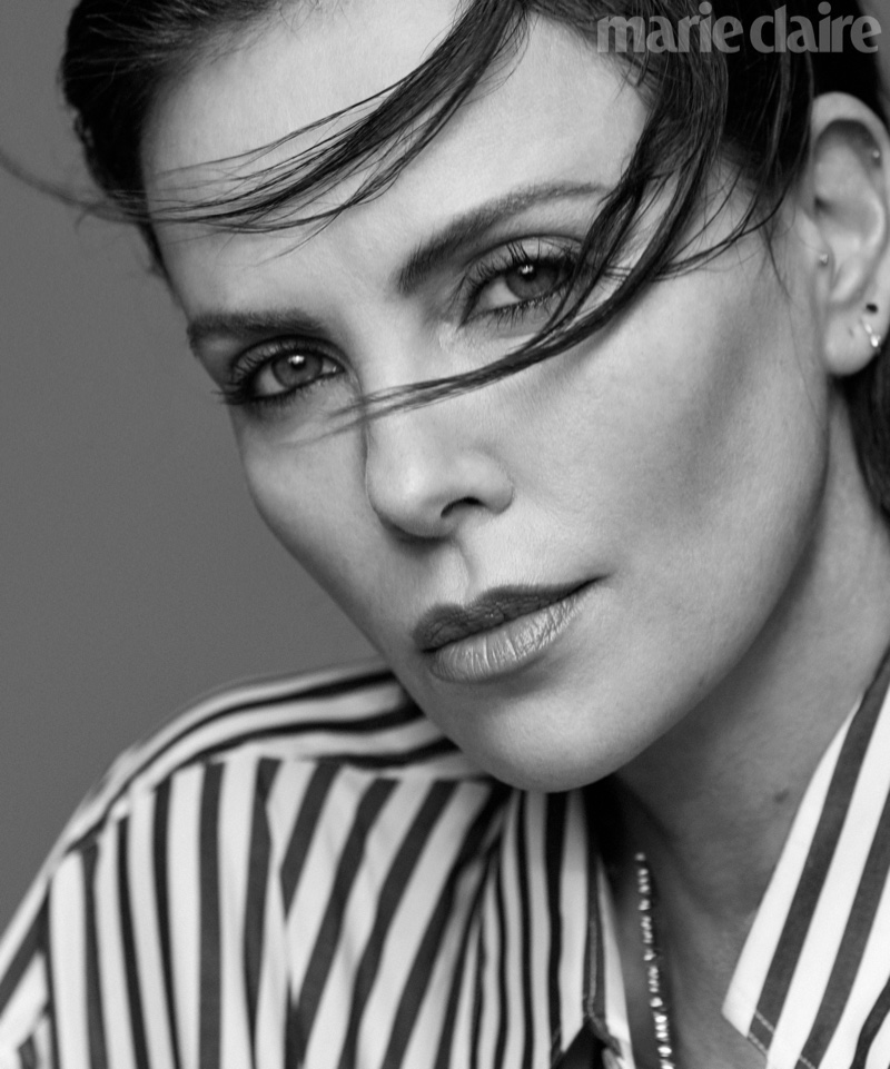 Ready for her closeup, Charlize Theron wears Marc Jacobs top and Cartier necklace