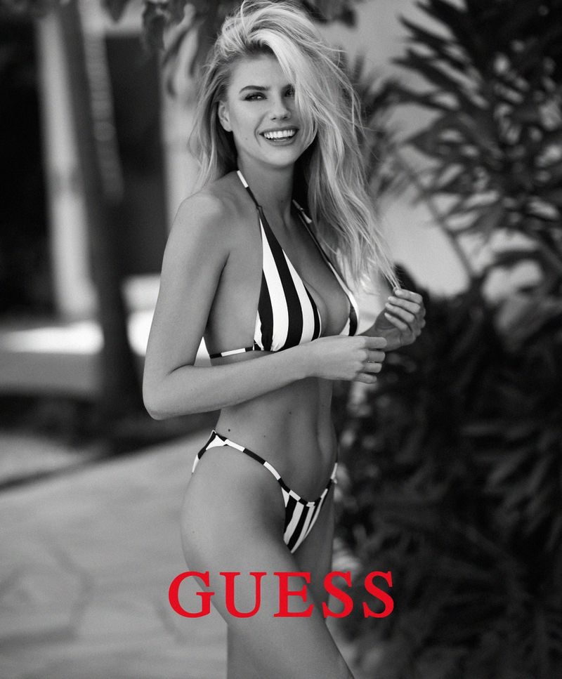 Flashing a smile, Charlotte McKinney poses for Guess swimsuit campaign