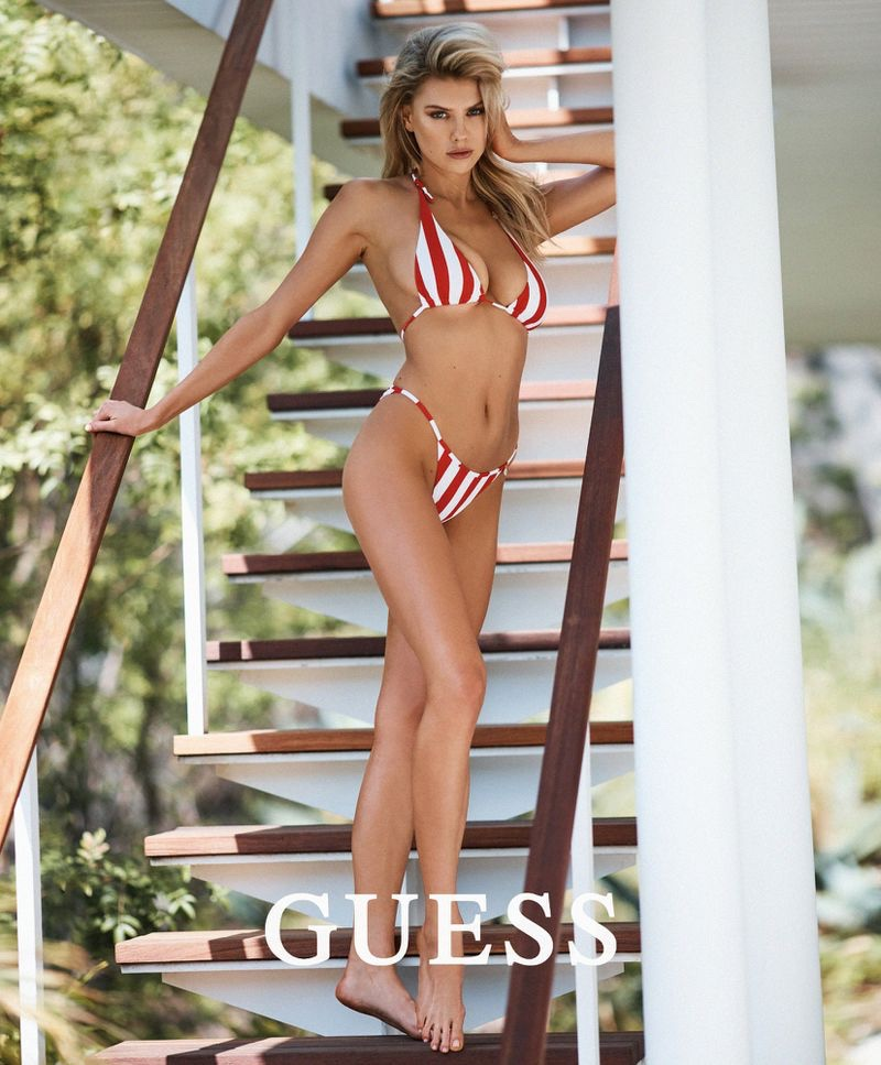 Wearing red stripes, Charlotte McKinney poses in Guess swimsuit collaboration