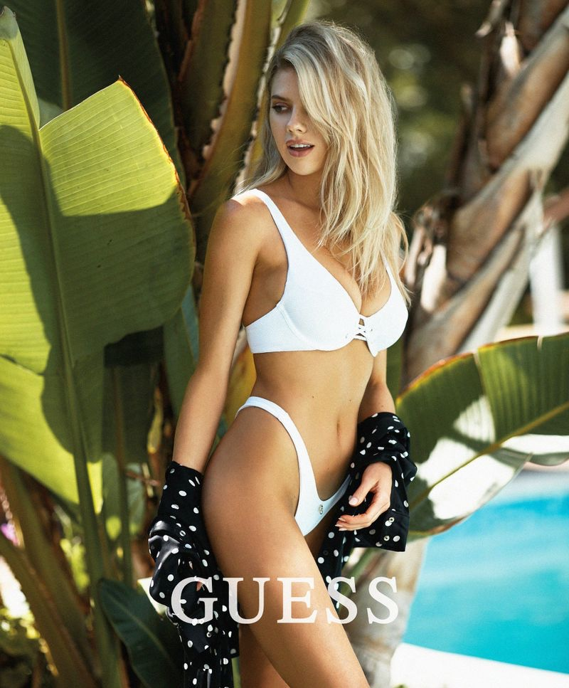 Looking white-hot, Charlotte McKinney poses for Guess swimsuit 2019 campaign