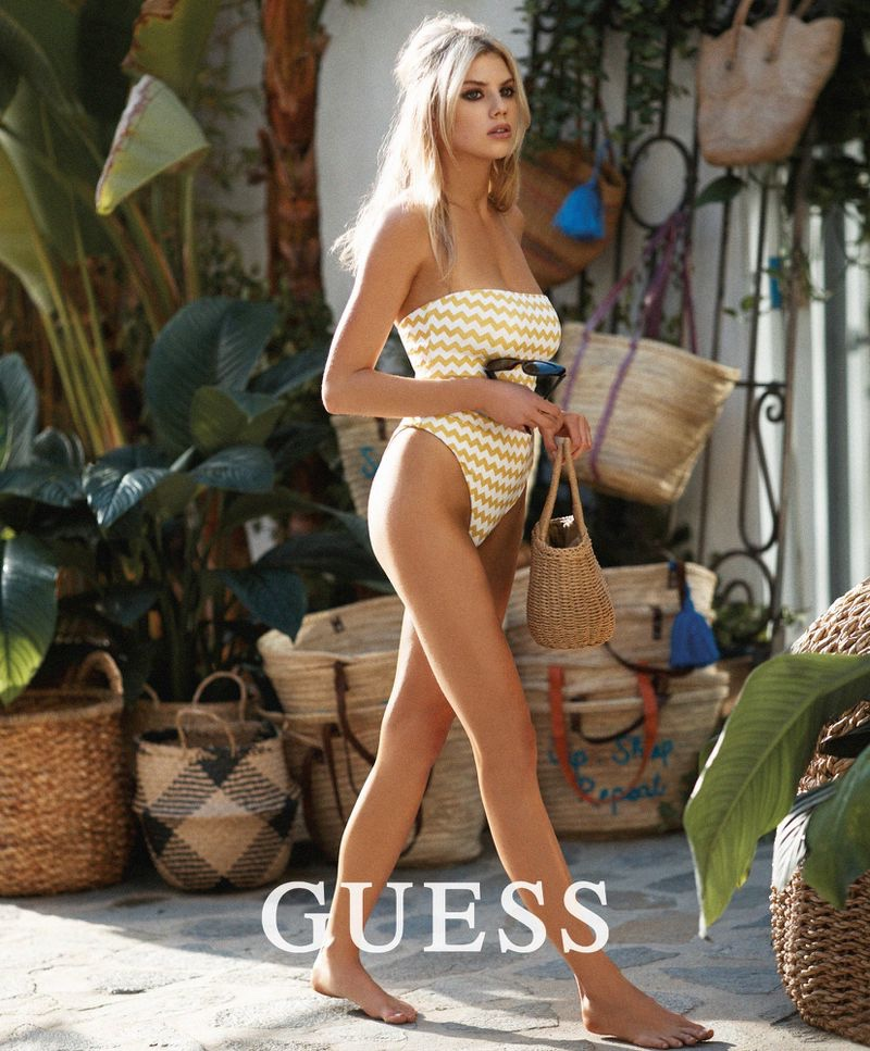Charlotte McKinney wears chevron print swimsuit from Guess