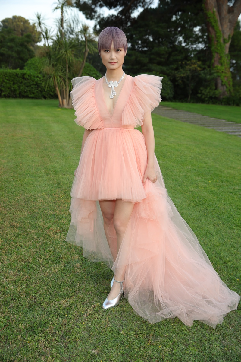 Chris Lee wears dress from Giambattista Valli x H&M collaboration.