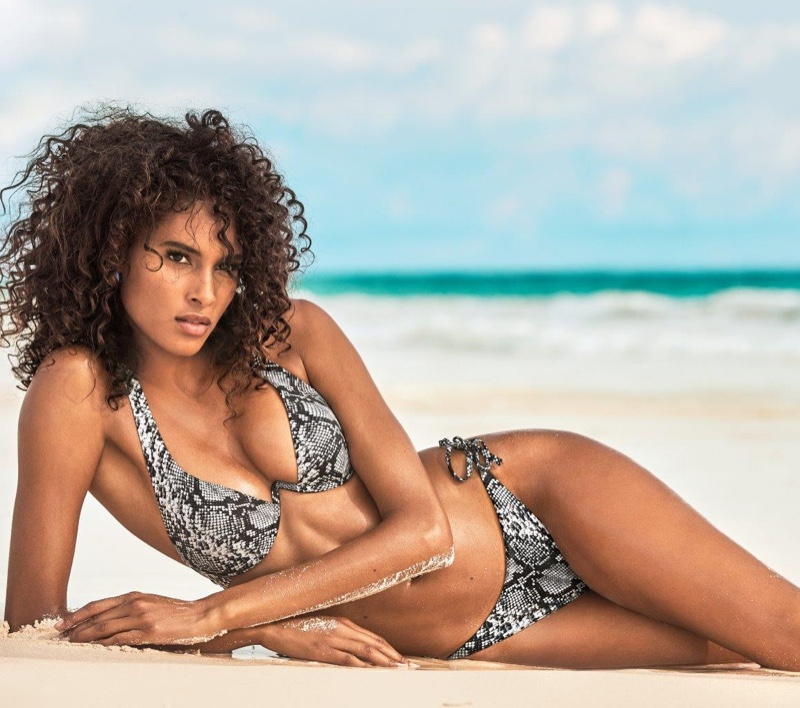 Model Cindy Bruna wears python print bikini from Calzedonia