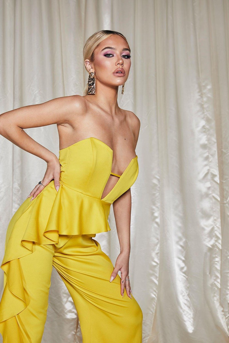 Striking a pose, Delilah Belle Hamlin wears yellow jumpsuit from Boohoo