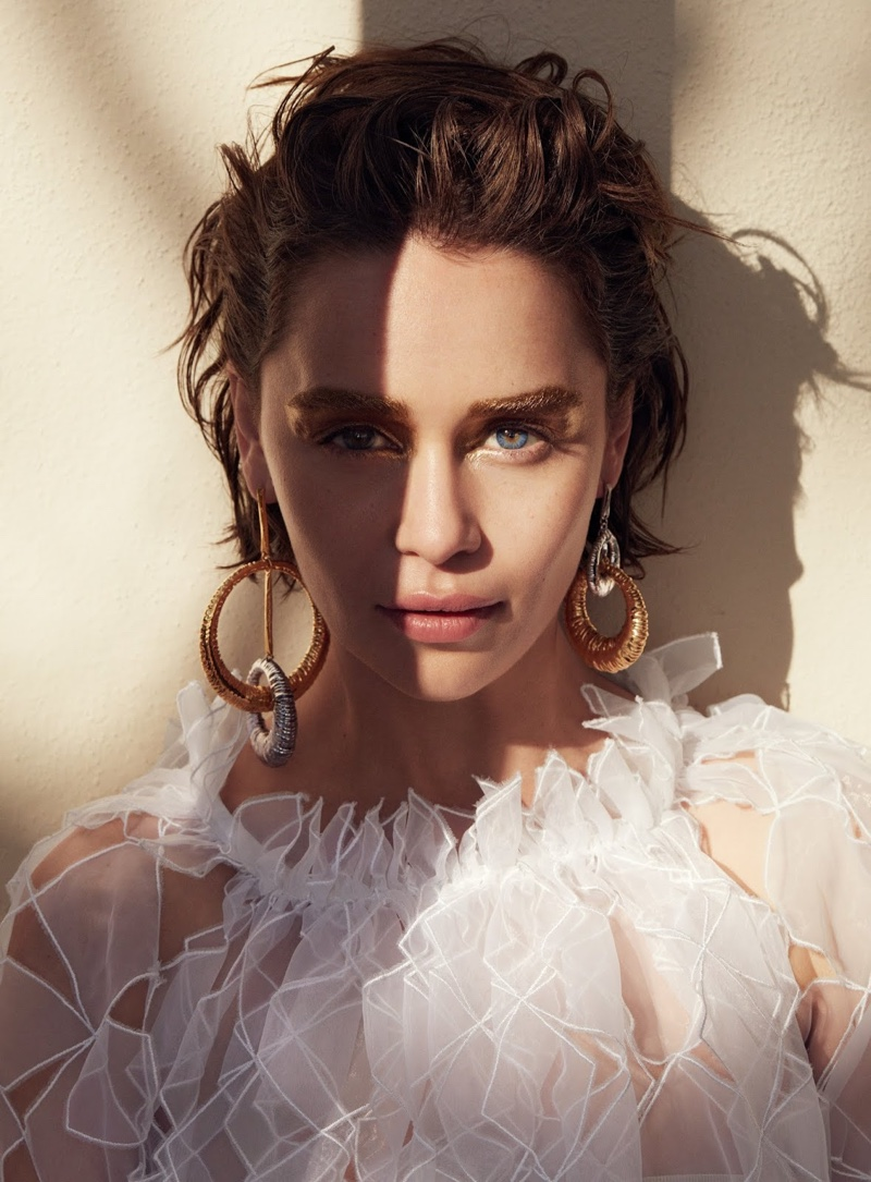 Ready for her closeup, Emilia Clarke poses in Christopher Kane dress with Givenchy earrings