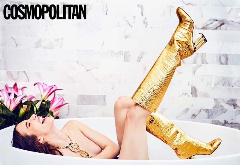 Wearing gold boots, Emma Roberts poses in a bath tub