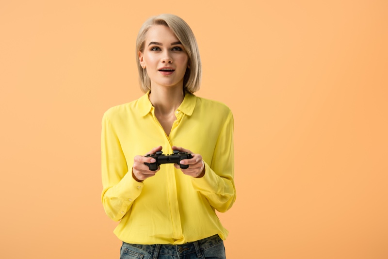 Fashion Model Playing Video Game
