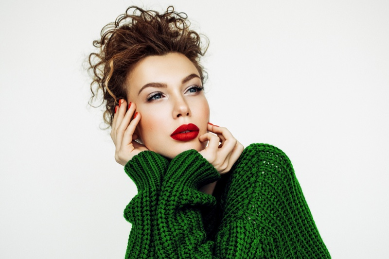 Model Red Lipstick Green Sweater