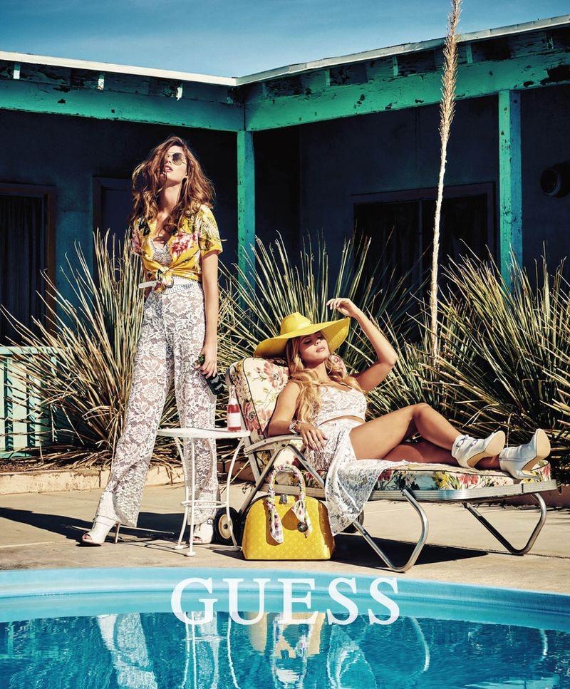 Posing poolside, Mishel Gerzig and Gwen Van Meir front Guess summer 2019 campaign