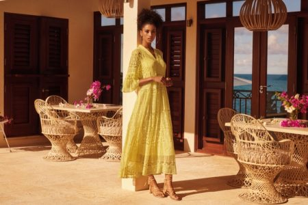Model Imaan Hammam wears H&M yellow lace dress