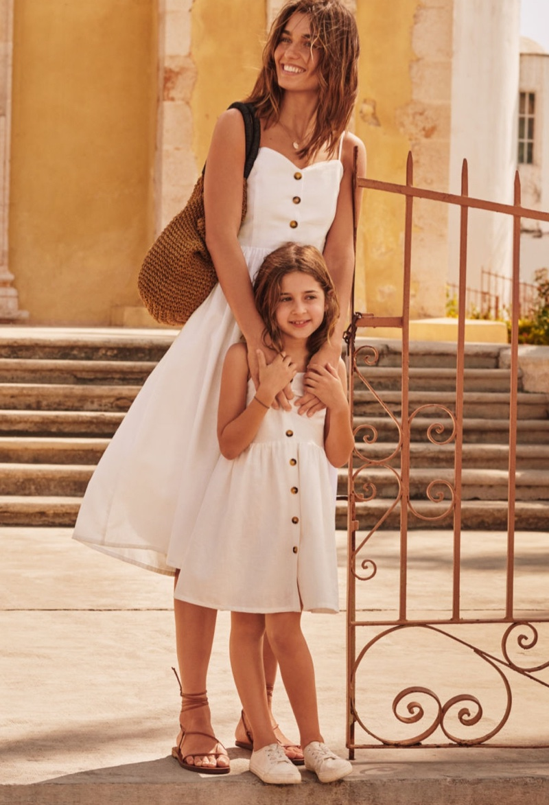 H&M spotlights mini-me style with button embellished dresses