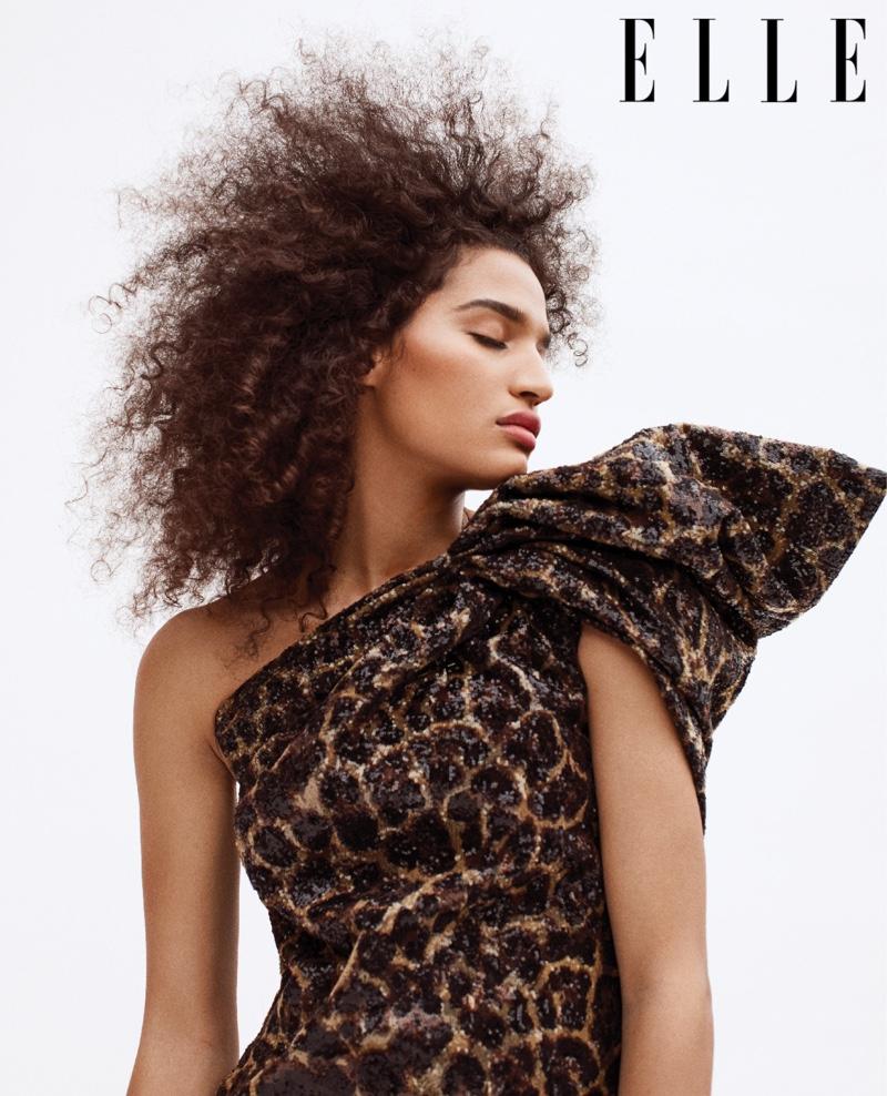 Indya Moore poses in a Saint Laurent dress