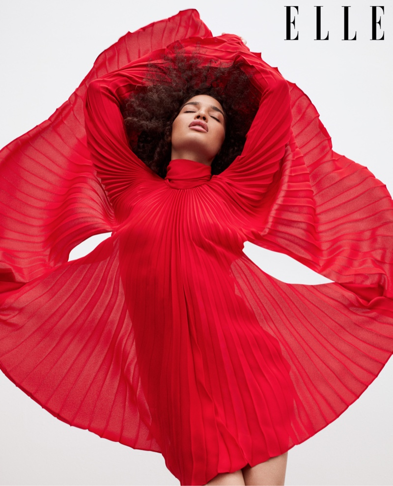 Striking a pose, Indya Moore wears a red Valentino dress