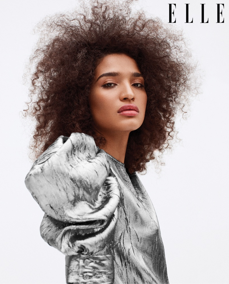 Actress Indya Moore poses in Michael Kors Collection blouse
