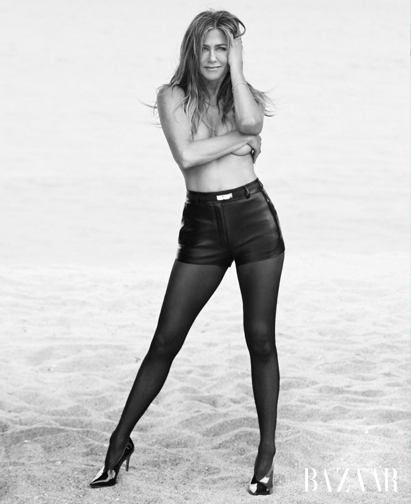 Posing topless, Jennifer Aniston wears Hermes shorts and belt, Wolford tights and Gianvito Rossi heels
