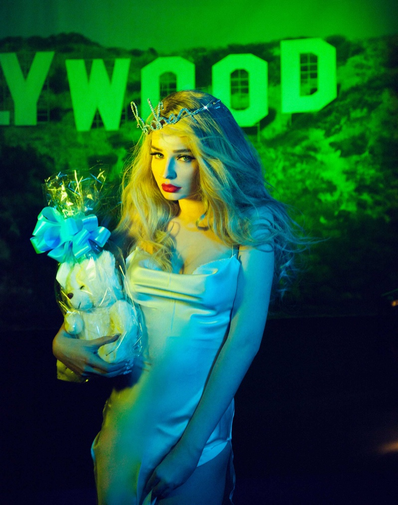 Kim Petras poses in Are You Am I dress