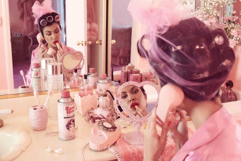 Kourtney Kardashian looks glam with a roller set hairstyle