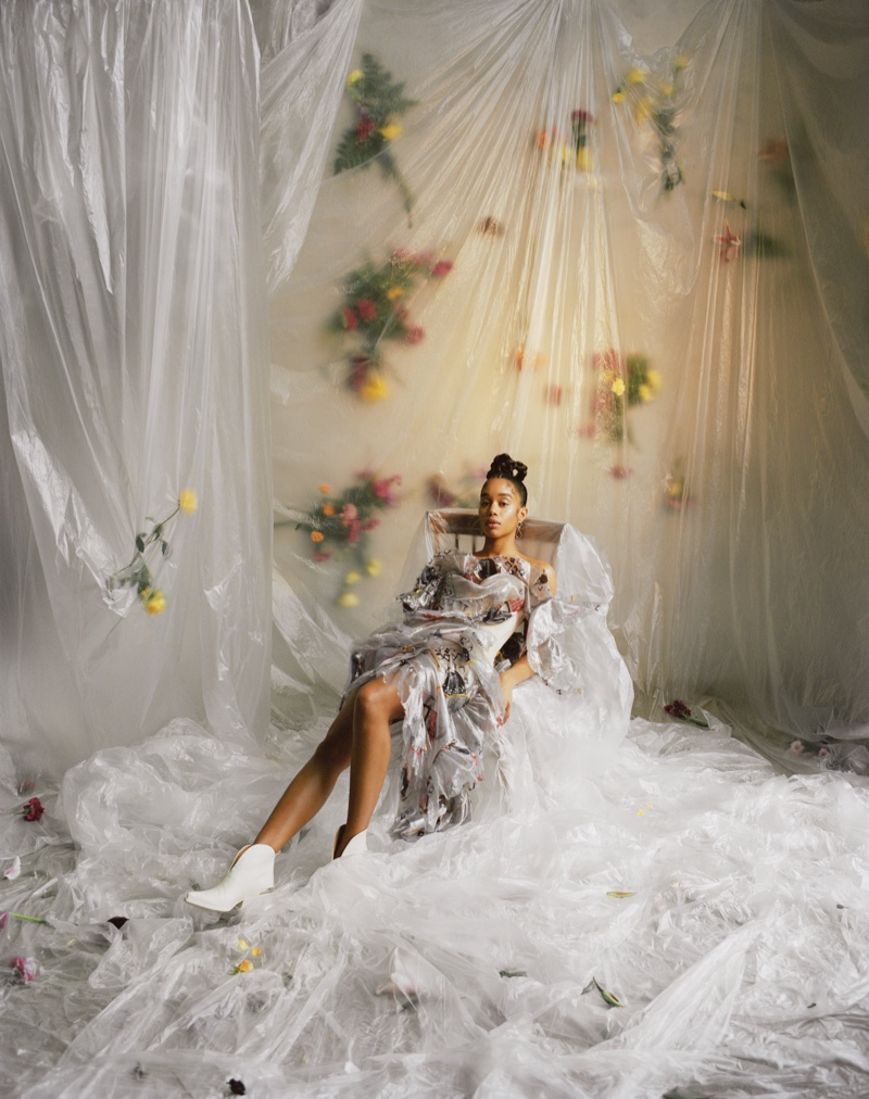Actress Laura Harrier poses in a room full of flowers. Photo: Mary Rozzi