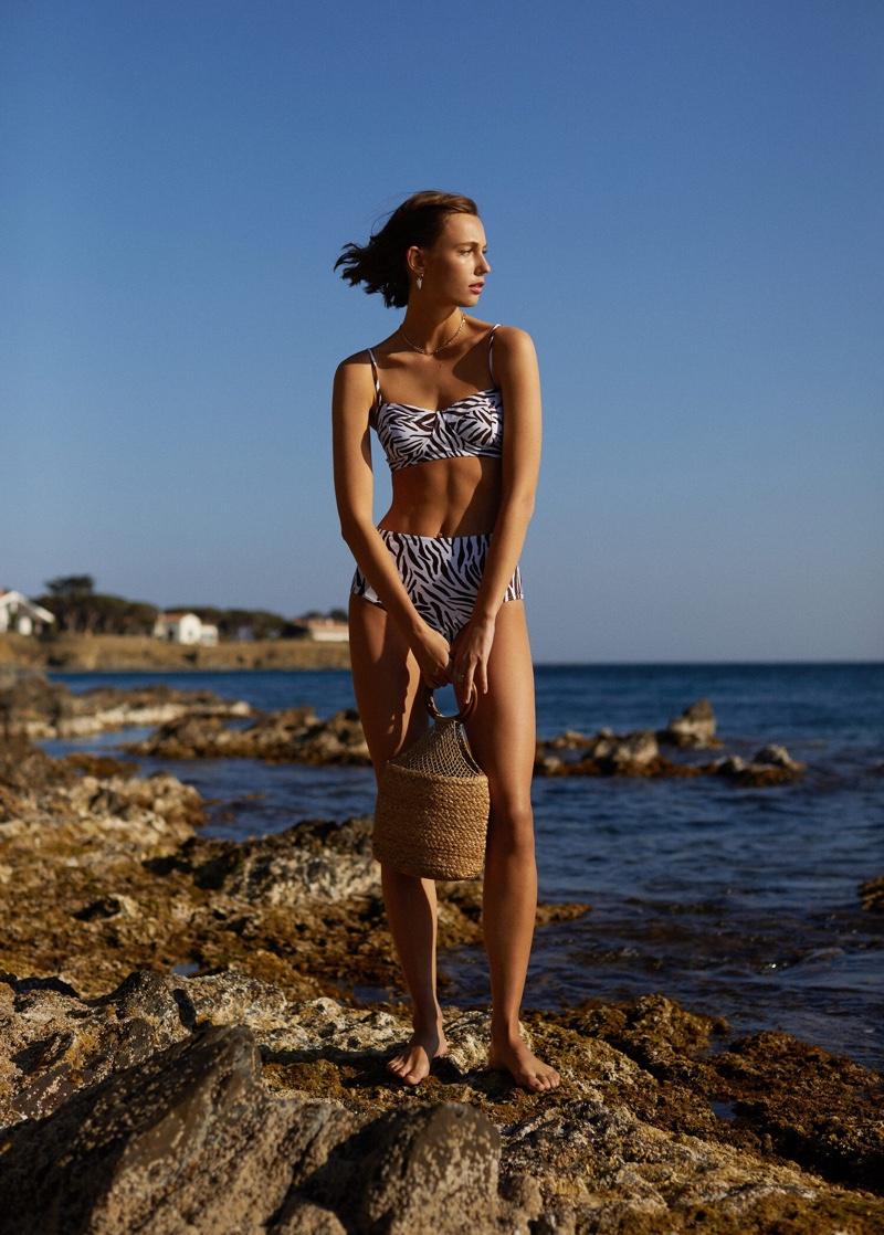 Channeling retro vibes, Mali Koopman wears high-waisted bikini from Mango
