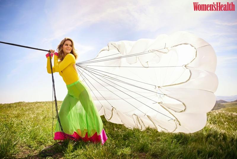Posing outdoors, Maren Morris wears Prabal Gurung bodysuit and skirt with Teva shoes