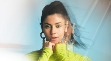 Sporting neon green, Marina Diamandis poses in Versace dress with Givenchy earrings
