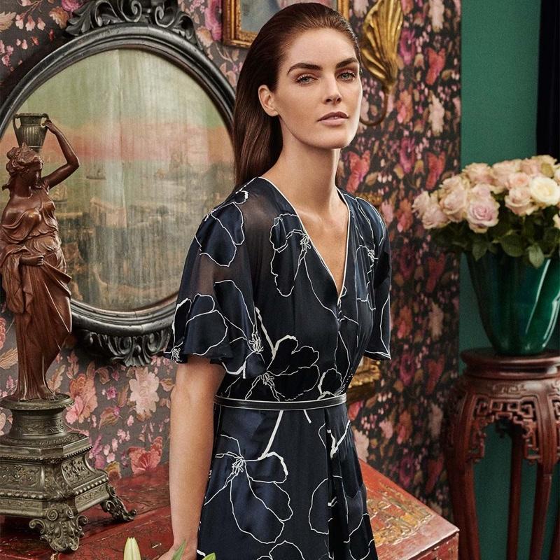 Model Hilary Rhoda wears Max Mara dress