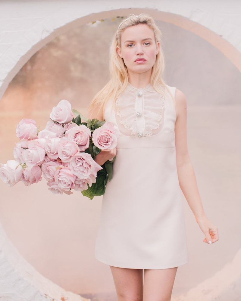 Georgia May Jagger wears Miu Miu lace-trimmed dress from Ceremony capsule collection