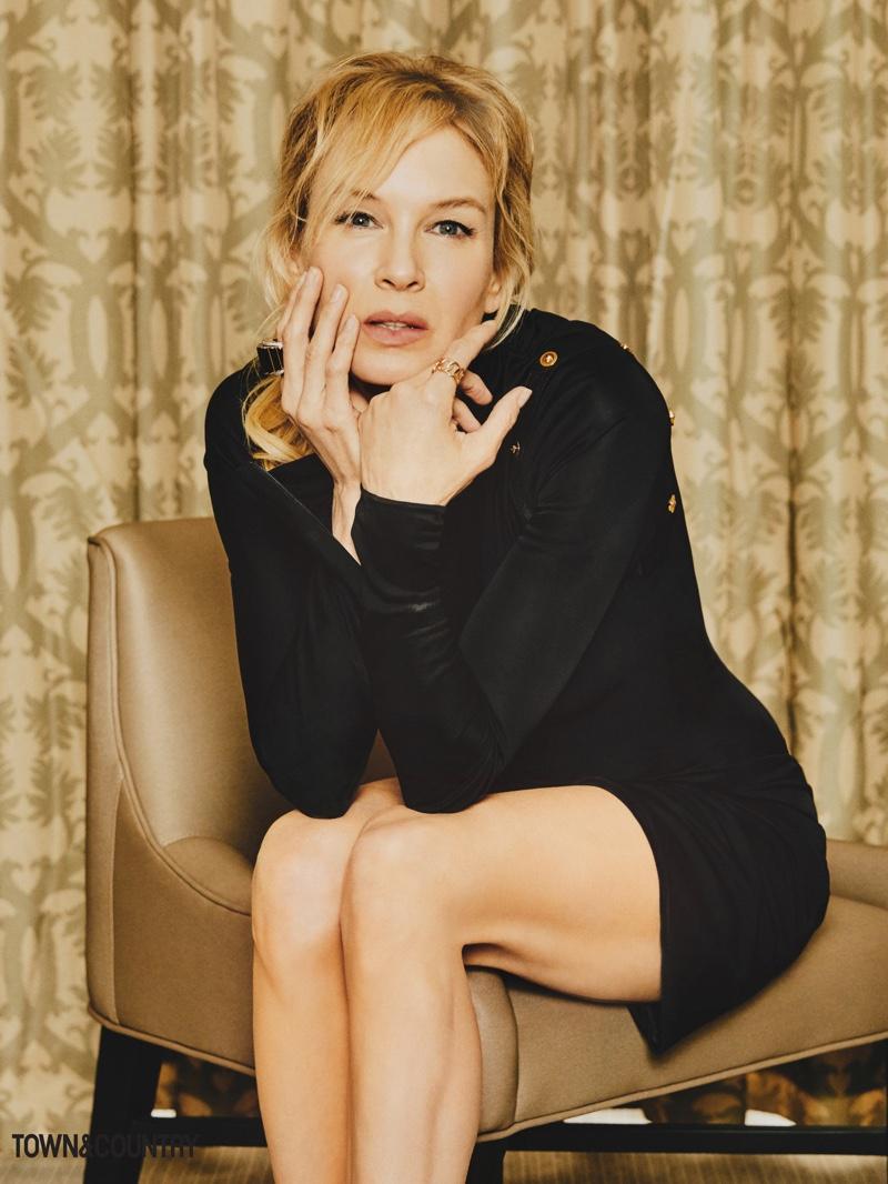 Actress Renee Zellweger wears black Versace dress