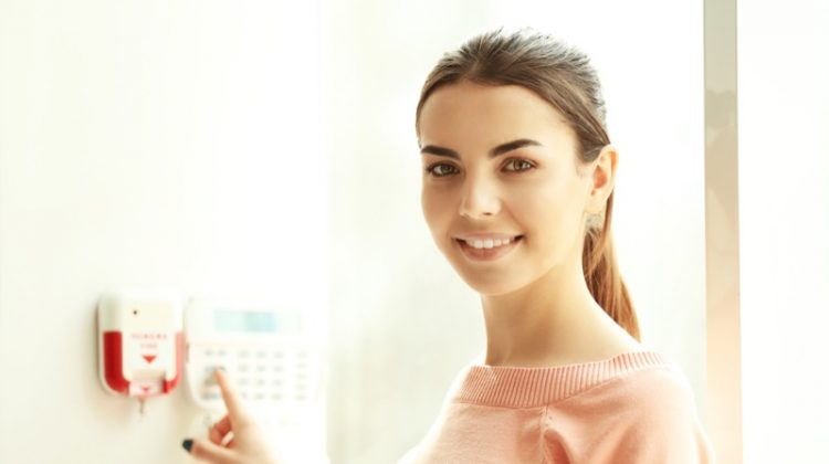Smiling Woman Pressing Security Buttons