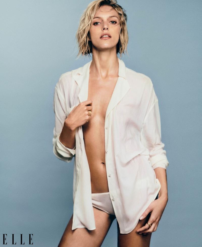 Anja Rubik poses in Emporio Armani blouse with Alanui panty and Bulgari rings