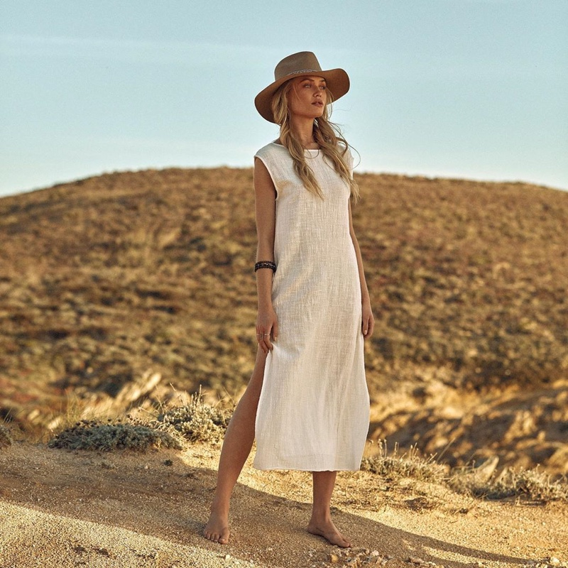 Camilla Christensen wears white coverup from Latitid summer 2019 collection
