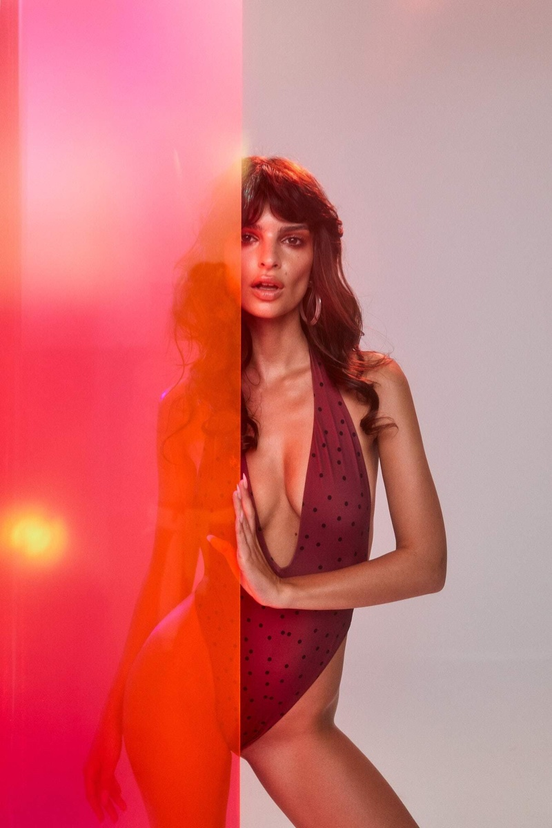 Wearing a plunging swimsuit, Emily Ratajkowski appears in Inamorata Swim summer 2019 campaign