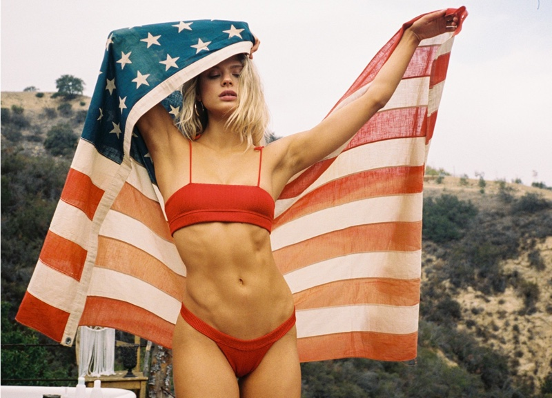 Posing with an American flag, Victoria Germyn rocks red set from Frankies Bikinis