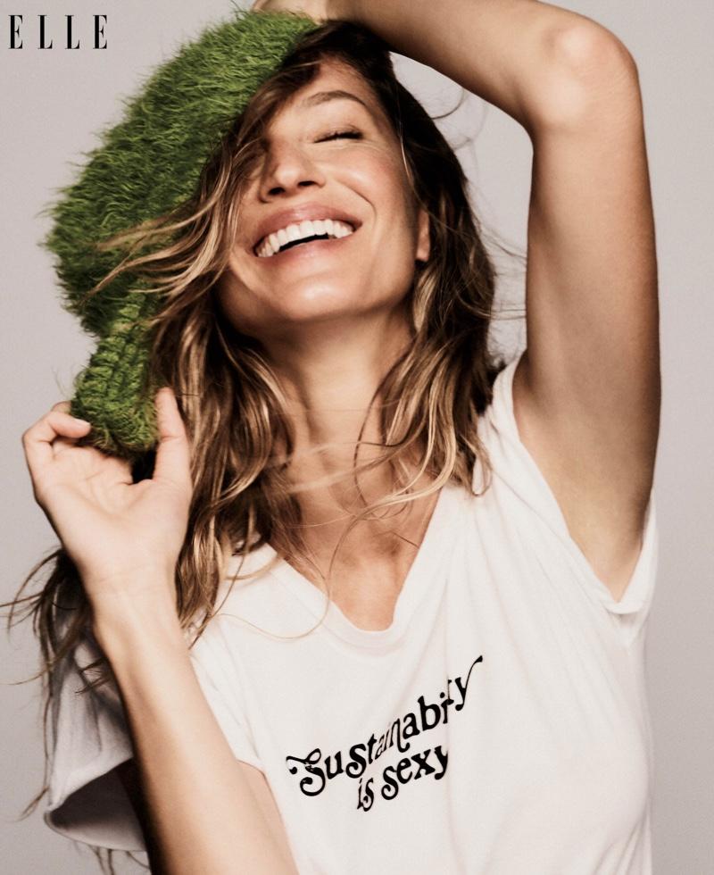Gisele Bundchen wears Vitamin A shirt and Marc Jacobs beanie