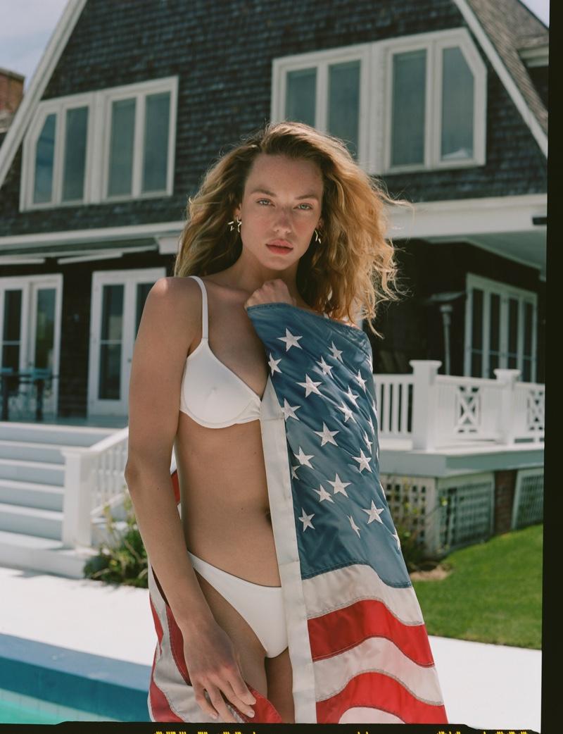 Wearing a white bikini, Hannah Ferguson models Solid & Striped x Re/Done collaboration