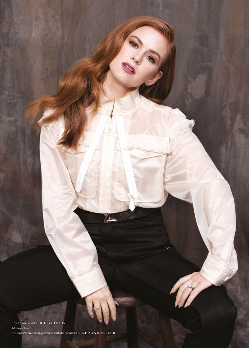 Isla Fisher poses in Louis Vuitton look