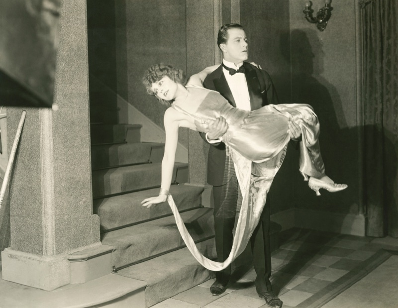 Man Carrying Woman 1920's 1930's Fashion Tuxedo Dress