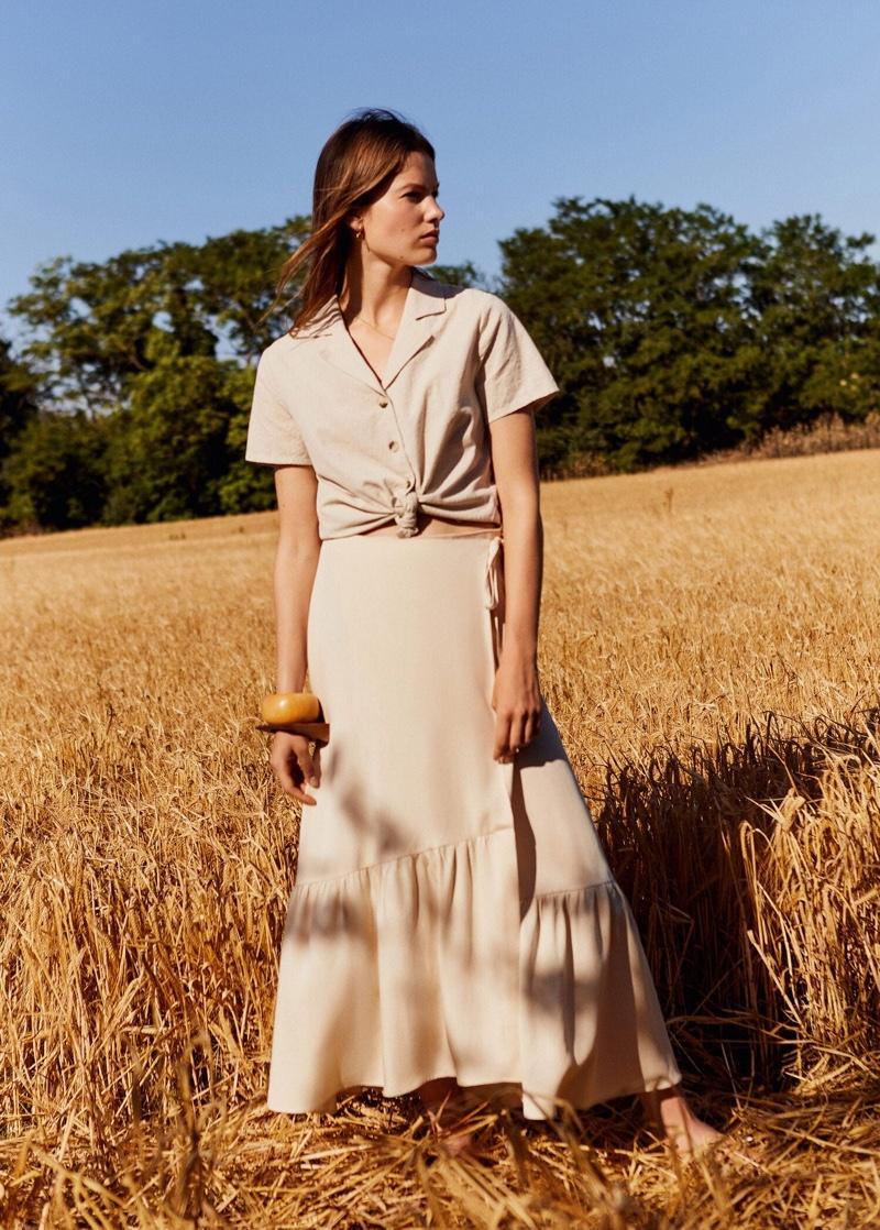 Posing outdoors, Roos van Elk fronts Mango A Countryside Affair editorial
