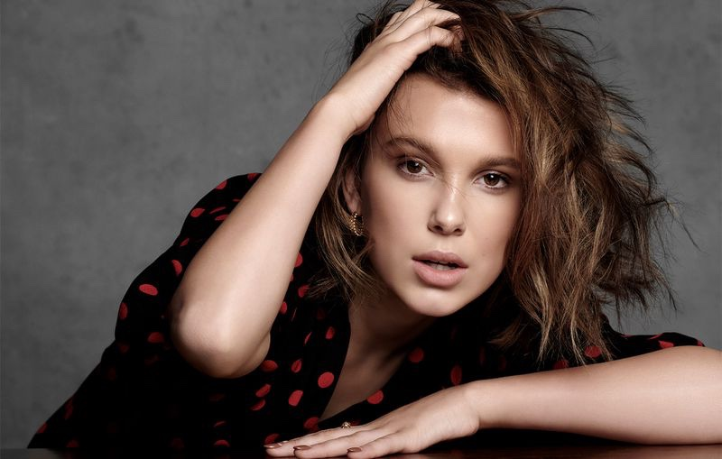 Actress Millie Bobby Brown poses in polka dot design