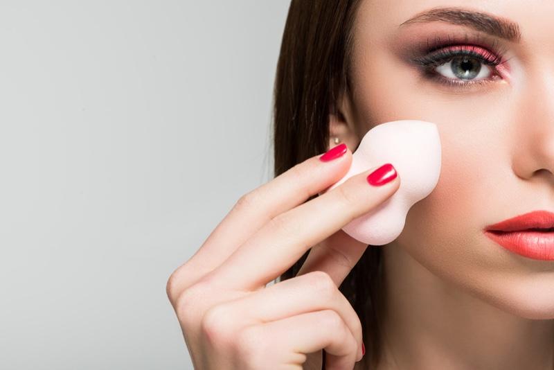 Model Doing Makeup Beauty Blender Closeup