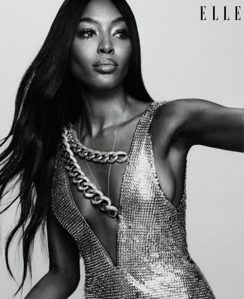 Turning up the shine factor, Naomi Campbell wears Tom Ford dress