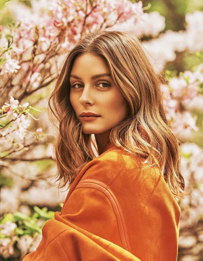 Showing off a wavy hairstyle, Olivia Palermo wears Hermes design