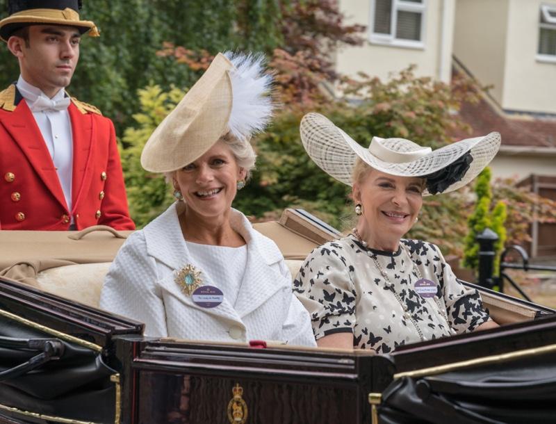 Stylish women during the carriage procession at Royal Ascot